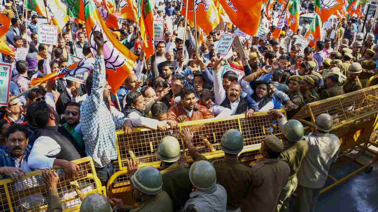 Bharatiya Janata Party (BJP) workers stage a protest against Congress government, in Ajmer. (Image: PTI)
