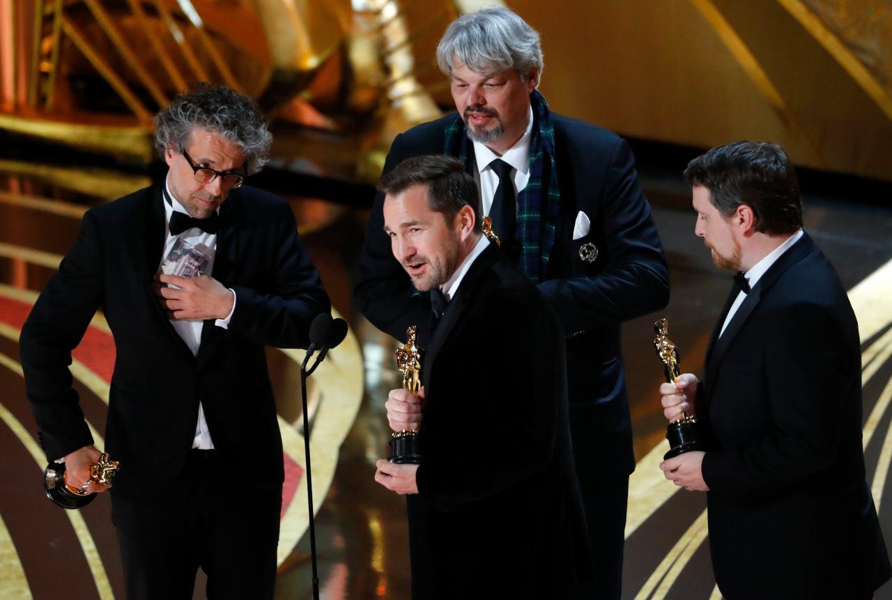 """Best Visual Effects: Paul Lambert, Ian Hunter, Tristan Myles and J D Schwalm, """"First Man"""" (Image: Reuters)"""