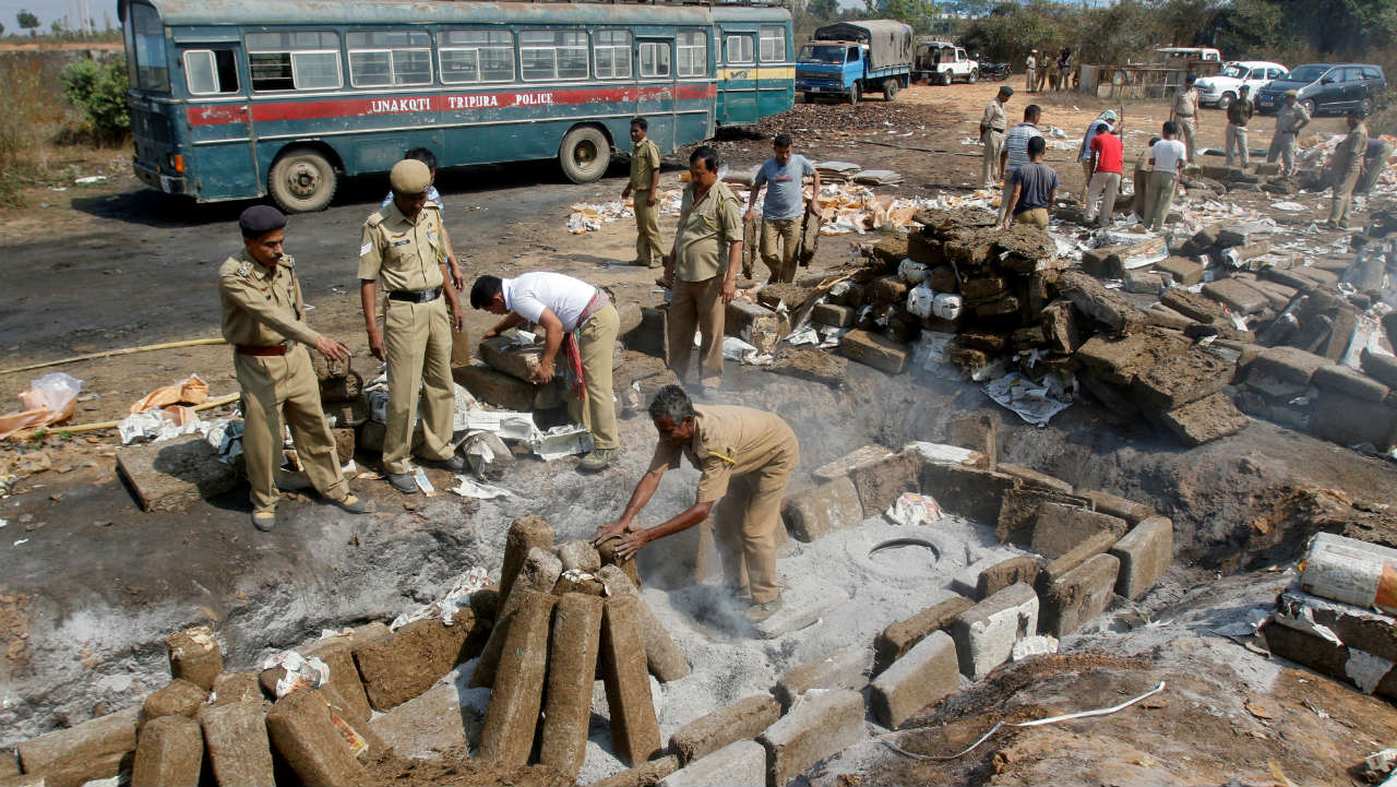 Policemen prepare to destroy seized cannabis at a dumping site on the outskirt of Agartala. (Image: Reuters)