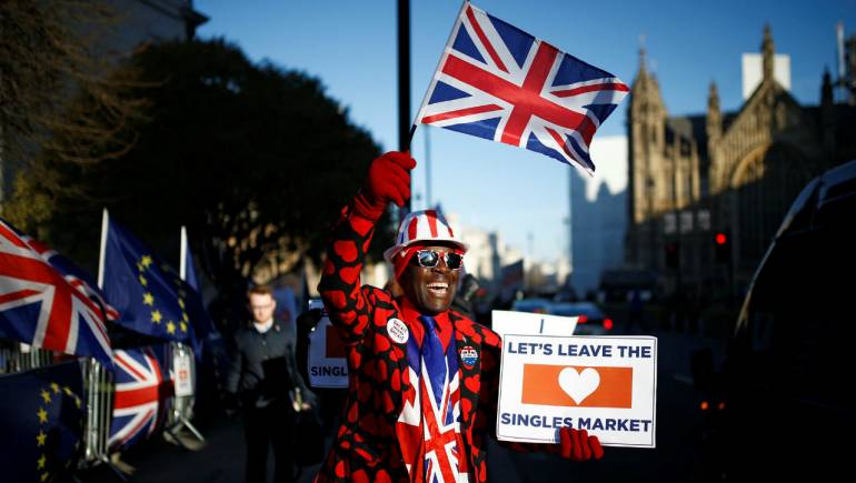 A pro-Brexit demonstrator protests outside the Houses of Parliament, in Westminster, London. (Image: Reuters)