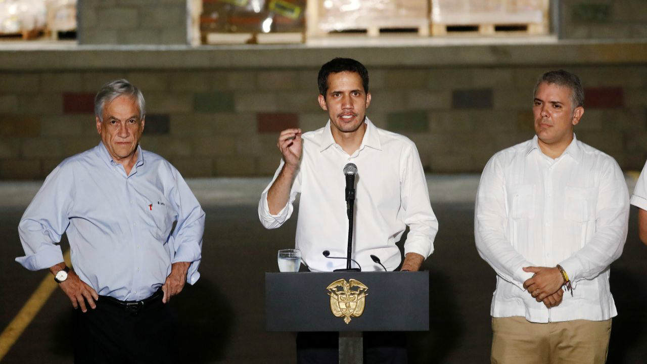 Colombia's President Ivan Duque, Chile's President Sebastian Pinera and Venezuelan opposition leader Juan Guaido, who many nations have recognized as the country's rightful interim ruler, attend a news conference outside the warehouse where international humanitarian aid for Venezuela is being stored, near the Tienditas cross-border bridge between Colombia and Venezuela in Cucuta, Colombia. (Reuters)