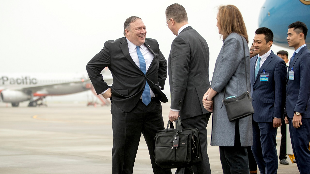 US Secretary of State Mike Pompeo speaks with US Ambassador to Vietnam Daniel Kritenbrink as he arrives at Noi Bai International Airport in Hanoi. (Image: Reuters)