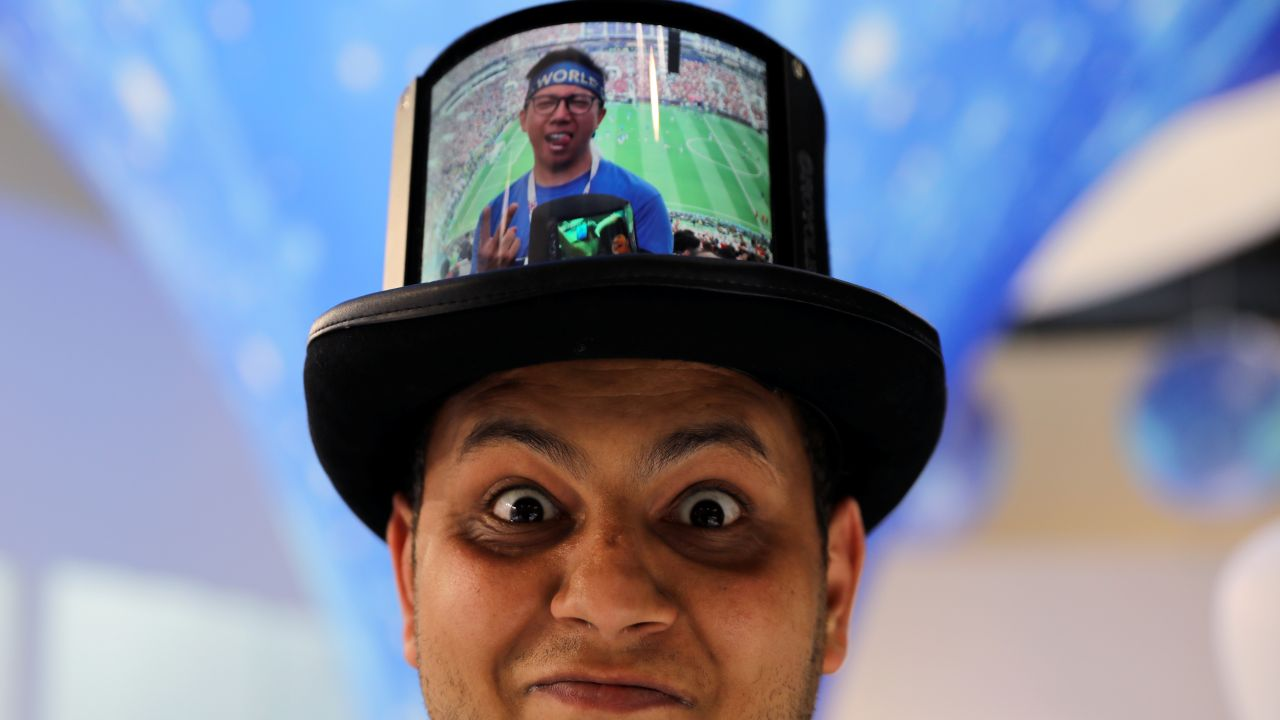 A visitor poses while wearing a hat packed with a Flexible+ display by the Chinese company Royole at the Mobile World Congress in Barcelona, Spain, February 26, 2019. REUTERS/Sergio Perez - RC112AF92320