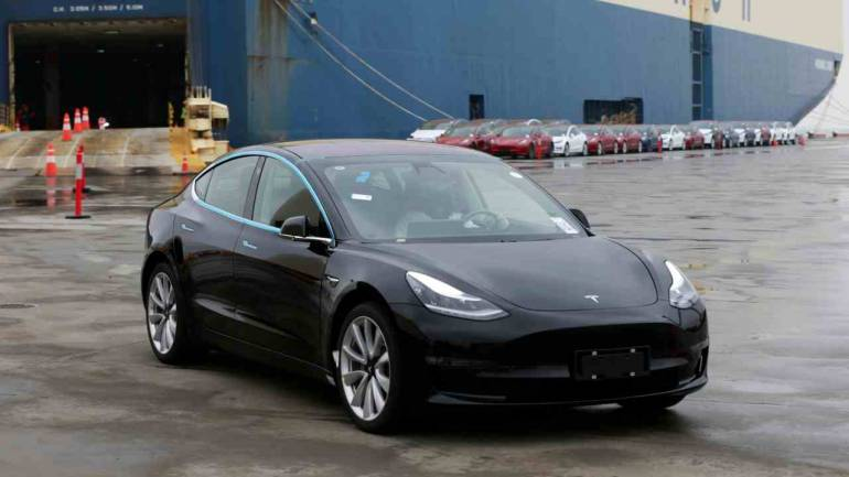 2. Tesla Model 3   This is another model by the American automotive company. The compact EV sedan has a range of 580 km. It won critical acclaim across the world when it was released in 2016. (Image: Reuters)