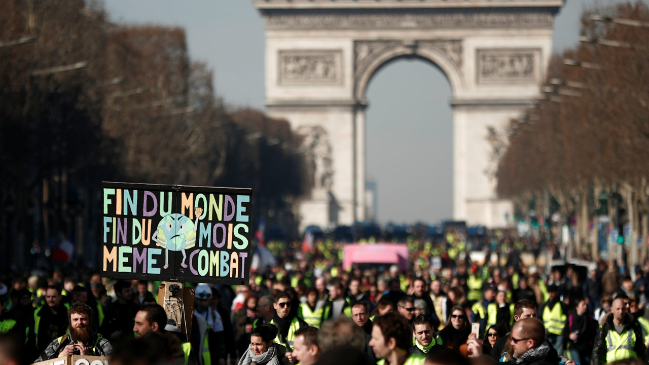 "Protesters wearing yellow vests walk down the Champs Elysees from the Arc de Triomphe as they take part in a demonstration by the ""yellow vests"" movement in Paris, France. (Image: Reuters)"