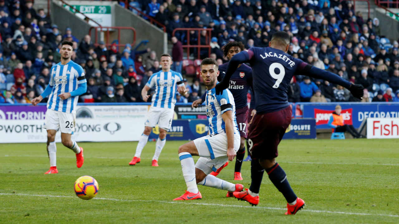 Huddersfield 1 – 2 Arsenal | The Gunners recorded their first away win since November at bottom placed Huddersfield thanks to first-half strikes from Alex Iwobi and Alexandre Lacazette. Huddersfield scored their first goal in 597 minutes of football across all competitions when Sead Kolasinac deflected the ball into his own net in the 93rd minute, setting up a nervy finish. (Image: Reuters)