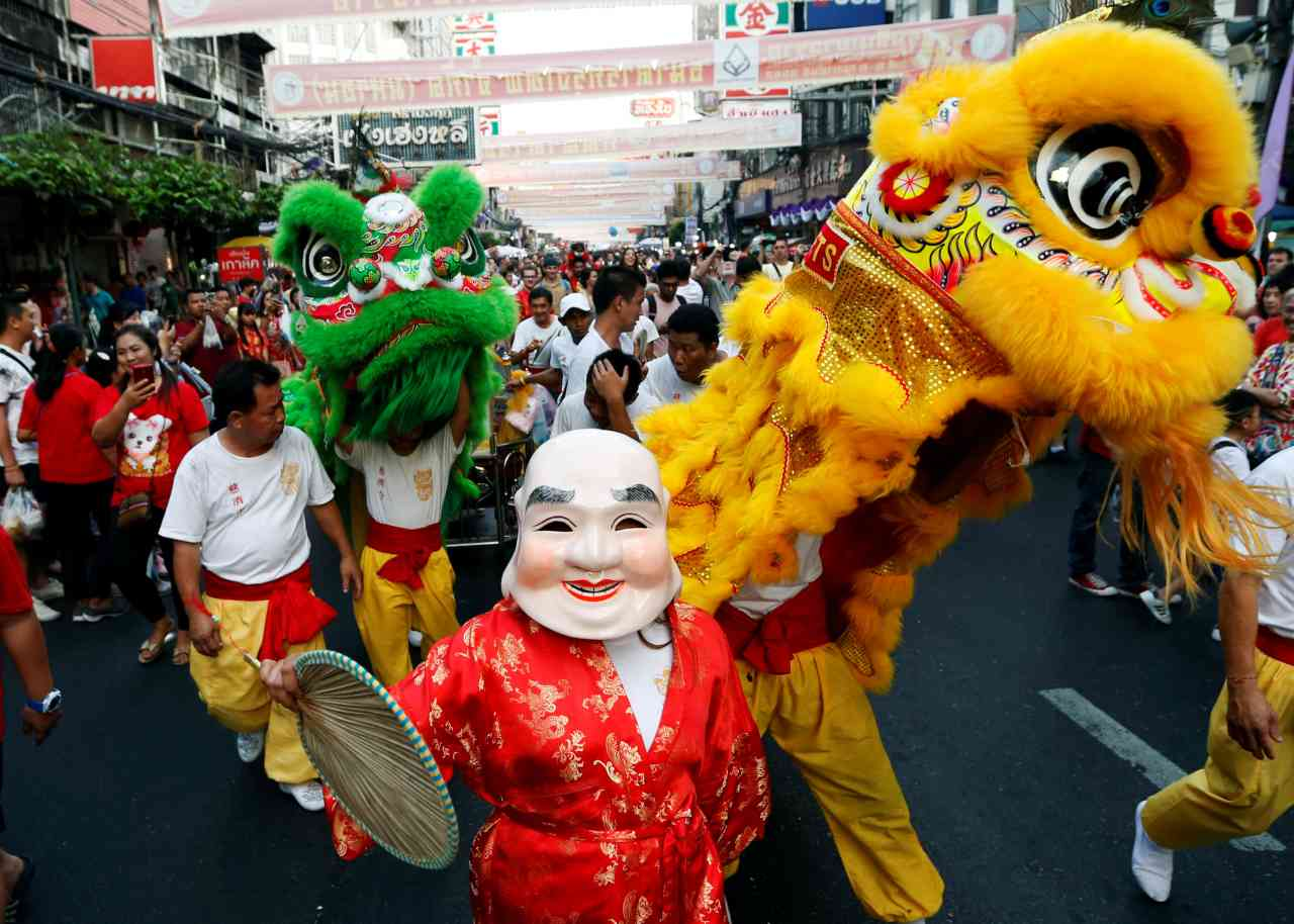 Streets in China and other Chinese dominated communities across the world were decorated, with kiosks set up as traditional dragon dancers leapt in the air. (Image: Reuters)