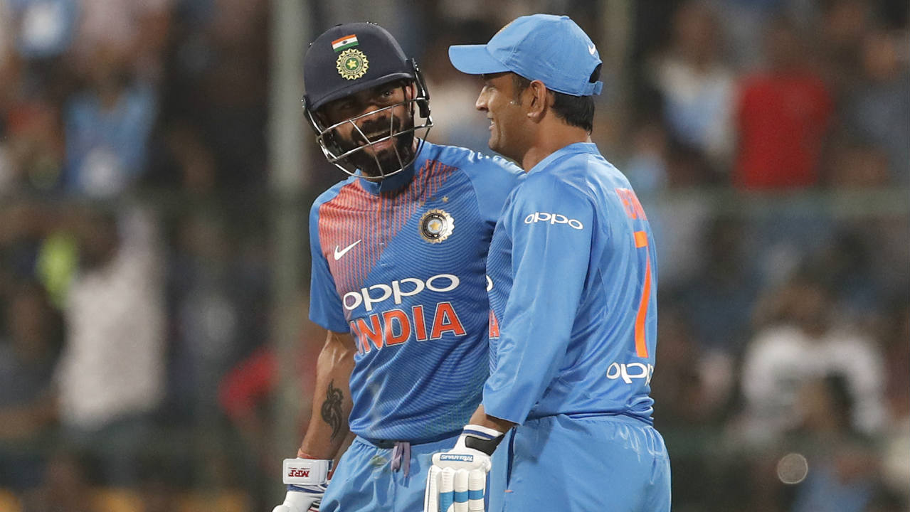 Virat Kohli brought up his fifty in the 17th over off just 29 balls. The Indian skipper hit four 6's and one 4 en route to his half-century. Kohli and Dhoni stitched together a 100-run partnership off just 50 balls to put India in a dominant position. The partnership ended in the 20th over when Dhoni (40) miscued a shot off Pat Cummins to Aaron Finch at long-off. Kohli (72*) and Karthik (8*) added 16 off the last 5 balls to take India to 190/4 after 20 overs. (Image: AP)