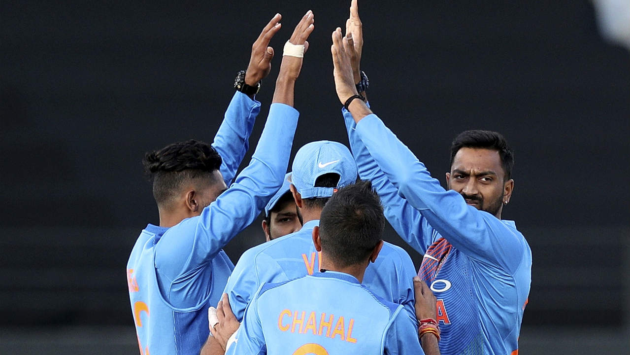 Bhuvneshwar Kumar and Krunal Pandya struck early for India getting rid of both Kiwi openers. Bhuvi first got Seifert caught behind in the 3rd over before Krunal got Munro to slice a shot straight towards Rohit at cover in the 5th over. Seifert and Munro who had scores of 84 and 34 respectively in the first T20I were dismissed for identical scores of 12. New Zealand were down to 41/2 at the fall of Munro's wicket. (Image: AP)