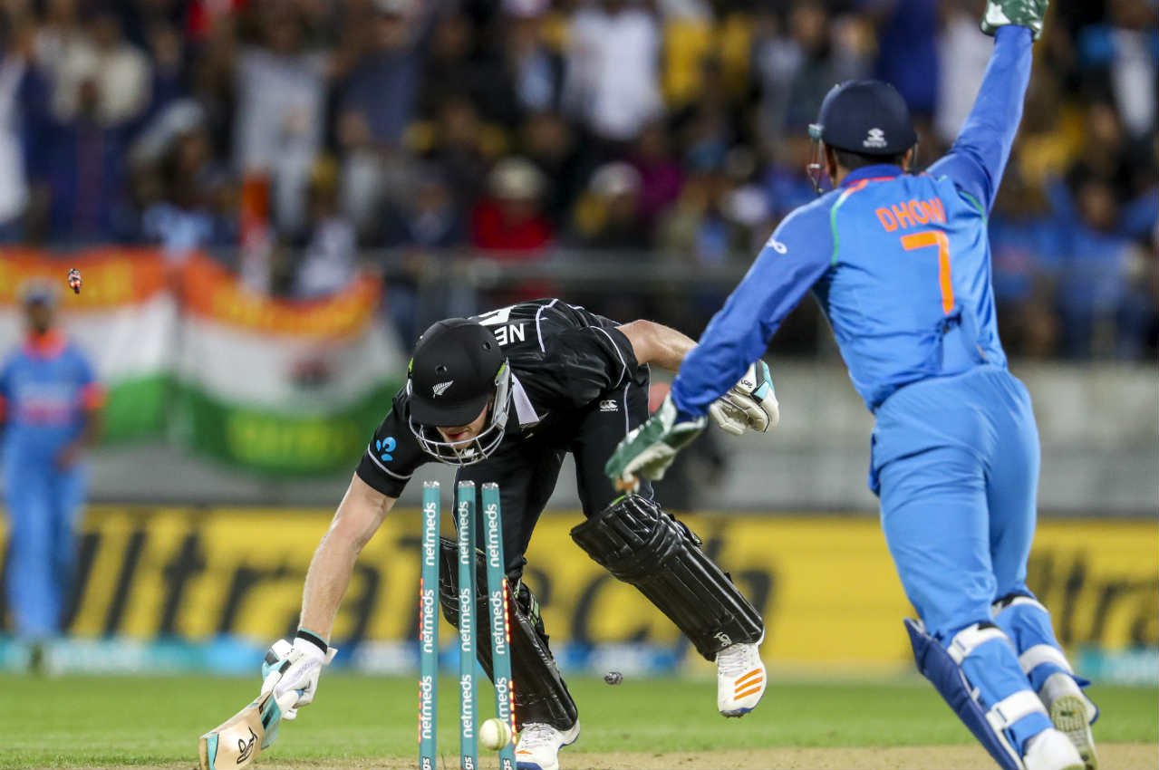 MS Dhoni exhibited great presence of mind to run out James Neesham in the 37th over. Neesham was looking dangerous having scored 44 off just 32 balls. He wandered out of the crease while Dhoni was appealing for LBW. The Indian wicketkeeper ran back to the ball and fired a direct-hit to end Neesham's innings. Chahal then picked up his third wicket of the night when he trapped Todd Astle LBW in the 41st over. New Zealand were down to 194/8 still 59 runs adrift of India's total. (Image: AP)