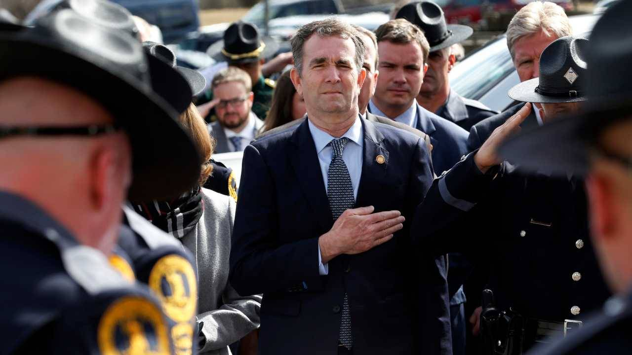 Virginia Governor Ralph Northam (left) and his wife Pam, watch as the casket of fallen Virginia State Trooper Lucas B. Dowell is carried to a waiting tactical vehicle during the funeral at the Chilhowie Christian Church in Chilhowie, Virginia. Dowell was killed in the line of duty earlier in the week. (Image: AP)