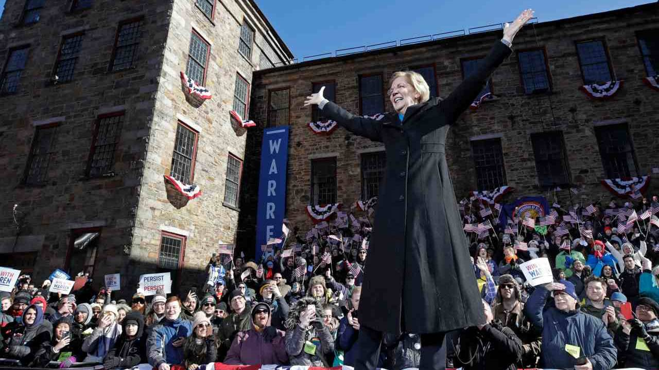US Senator Elizabeth Warren acknowledges cheers as she takes the stage during an event to formally launch her presidential campaign. (Image: AP)