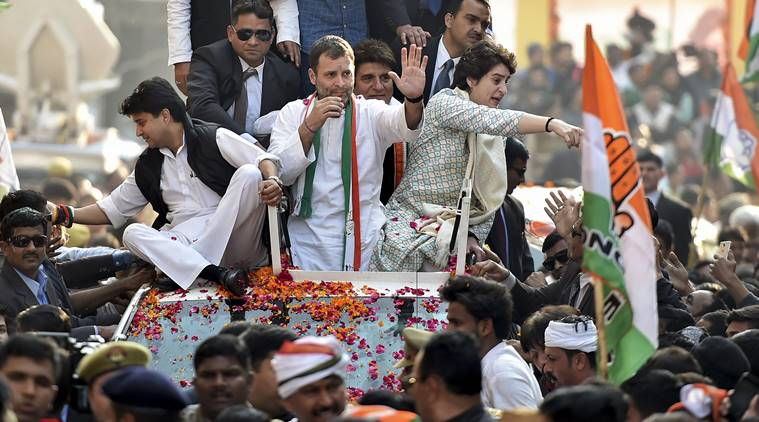 Congress President Rahul Gandhi with party general secretaries Priyanka Gandhi Vadra and Jyotiraditya Madhavrao Scindia during a roadshow, in Lucknow on Feb. -- PTI