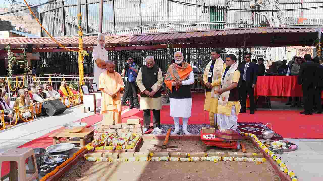 Prime Minister Narendra Modi lays the foundation stone for the Kashi Vishwanath Temple corridor in Varanasi. UP  Governor Ram Naik and CM Yogi Adityanath are also seen. (Image: PTI)