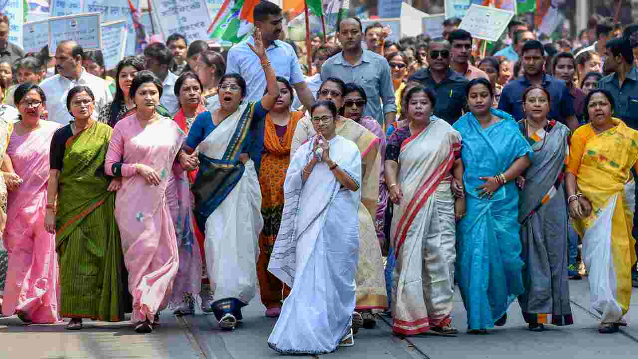 West Bengal Chief Minister Mamata Banerjee leads a 'walk', organised to mark International Women's Day in Kolkata. (Image: PTI)