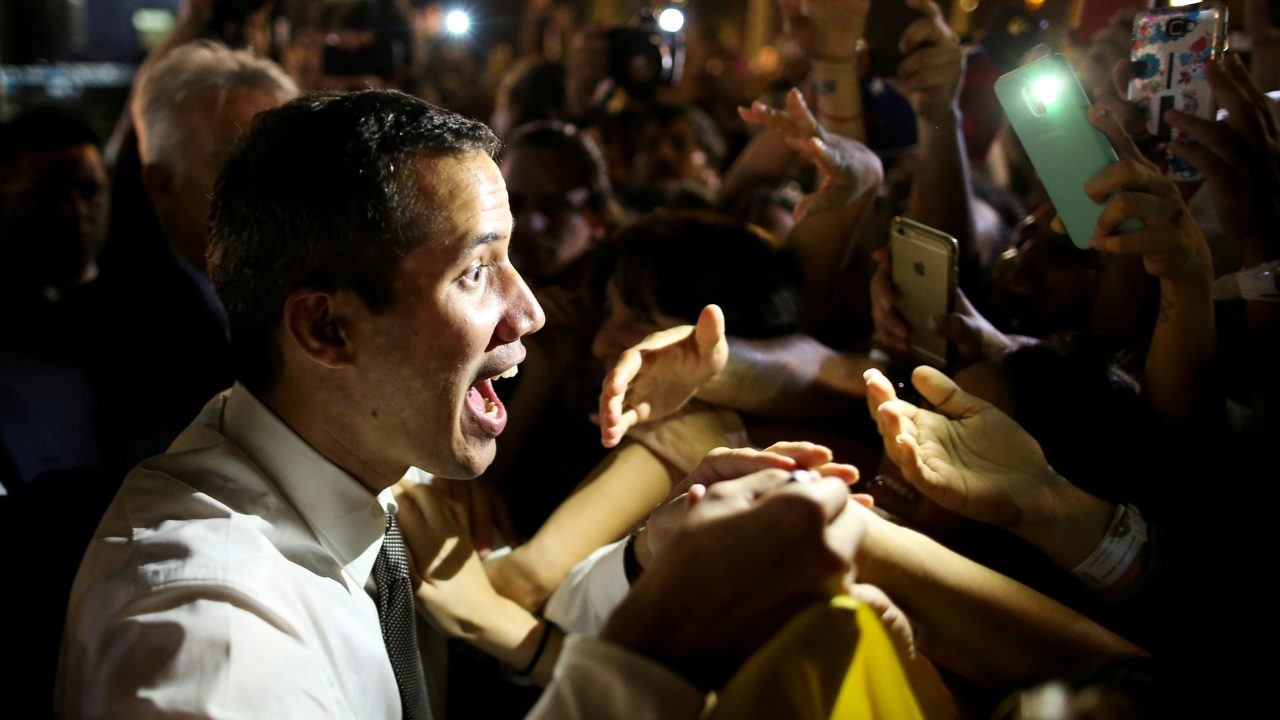 Venezuelan opposition leader Juan Guaido, who many nations have recognized as the country's rightful interim ruler, gestures to Venezuelan citizens after giving a news conference at the San Martin Palace in Buenos Aires, Argentina. (REUTERS)