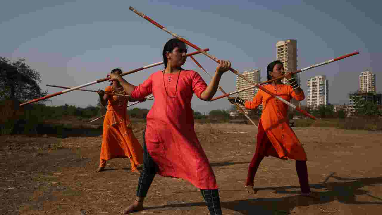 Women practice Shivkalin Yudha Kala, a Maharashtrian martial art on the eve of International Women's Day, at a ground on the outskirts of Mumbai. (Image: Reuters)