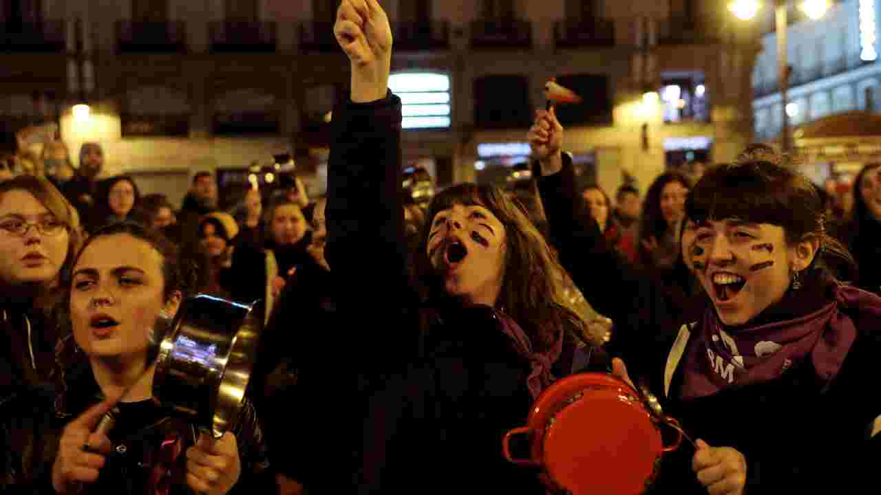 Women bang pots and pans during a protest at the start of a nationwide feminist strike on International Women's Day at Puerta del Sol Square in Madrid, Spain. (Image: Reuters)