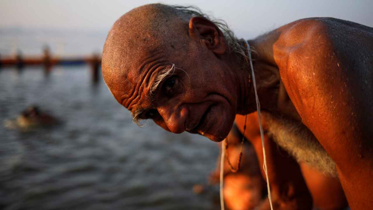A devotee prays after taking a holy dip at Sangam in Prayagraj. (Image: Reuters)