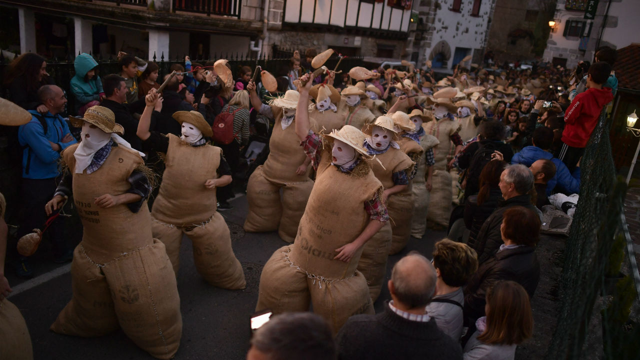 "People dressed as the traditional carnival characters ""Zaku Zaharrak,"" or old sack, in Basque language, take part during carnival parade in the small Pyrenean village of Lesaka, northern Spain. (Image: PTI)"