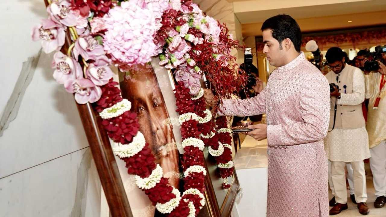 Akash Ambani, son of Mukesh Ambani, chairman of Reliance Industries, pays respects to his grandfather and founder of Reliance Industries Dhirubhai Ambani ahead of his wedding with Shloka Mehta.
