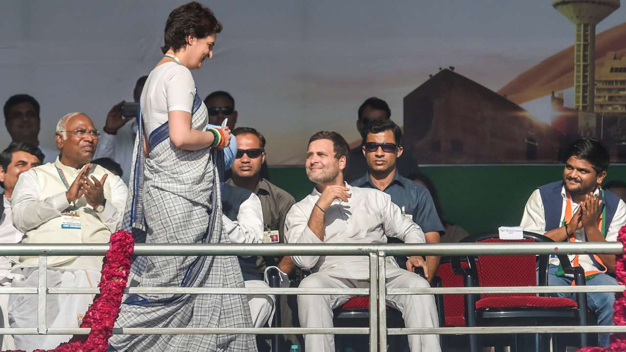 Congress General Secretary Priyanka Gandhi walks towards the podium to address party workers as Congress President Rahul Gandhi looks on during Jan Sankalp Rally in Gandhinagar on March 12. (Image: PTI)