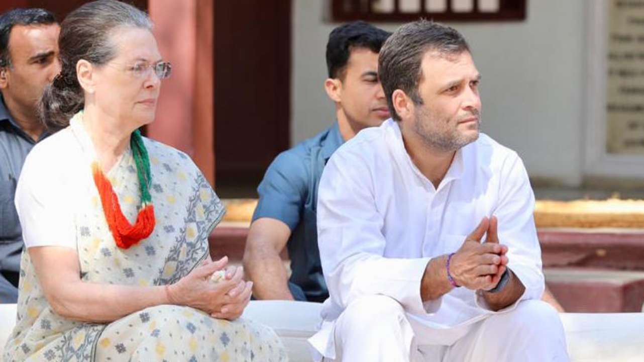 UPA Chairperson Sonia Gandhi and Rahul Gandhi spend time at the Gandhi Ashram in Sabarmati on March 12. (Image: Twitter/ @INCIndia )