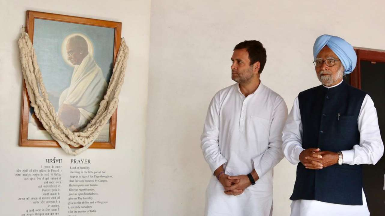 Former prime minister Manmohan Singh and Rahul Gandhi pay their tributes at the Gandhi Ashram in Sabarmati, Ahmedabad on March 12. (Image: Twitter/@INCIndia)