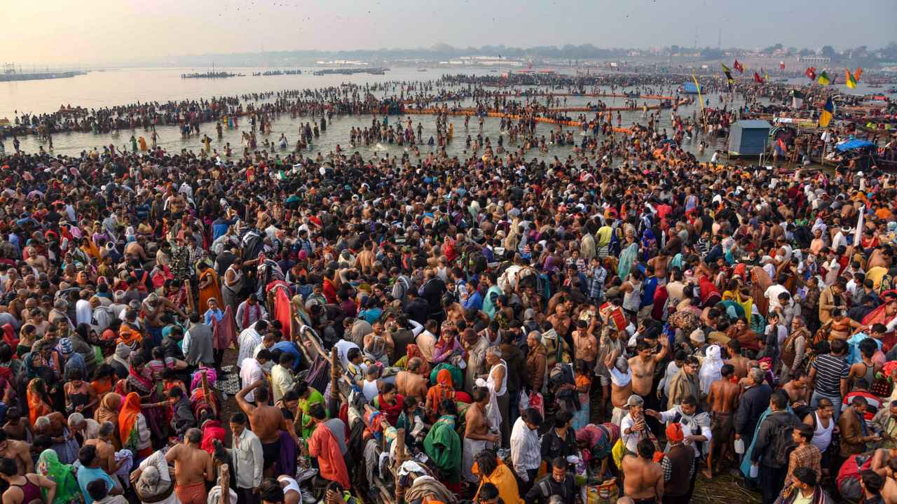 Devotees offer prayer and take holy dip on the occasion of 'Maha Shivaratri' festival during the ongoing Kumbh Mela, in Prayagraj. (Image: PTI)