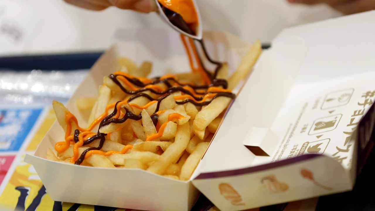 6. McDonald's visor and a large fries | Let us hope it was a cheat day for the cab driver, because no one can resist fries. (Image: Reuters)