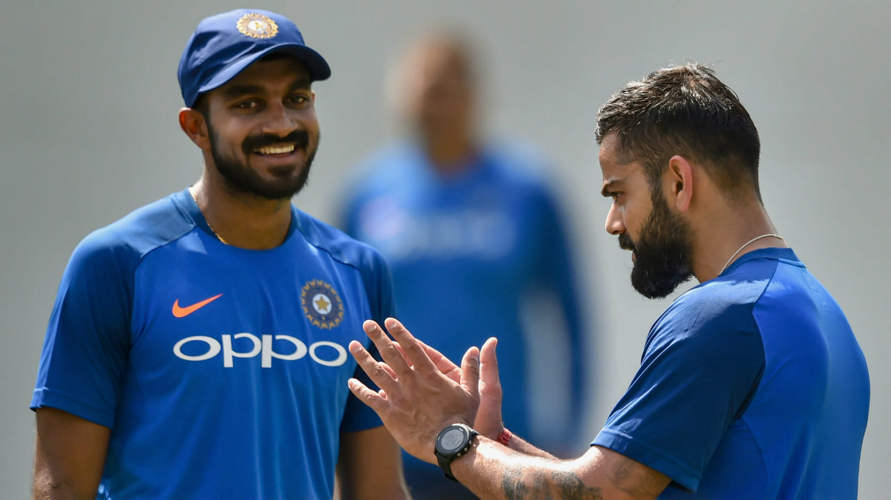 Skipper Virat Kohli talks to Vijay Shankar during a practice session ahead of the 2nd ODI cricket match against Australia, at Vidarbha Cricket Association Stadium in Nagpur, Maharashtra. (Image: PTI)