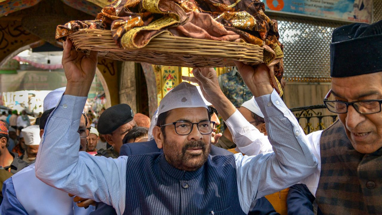 Union Minister for Minority Affairs Mukhtar Abbas Naqvi carries a 'chadar' to offer at Dargah Ajmer Sharif on behalf of the prime minister, in Ajmer. (PTI)