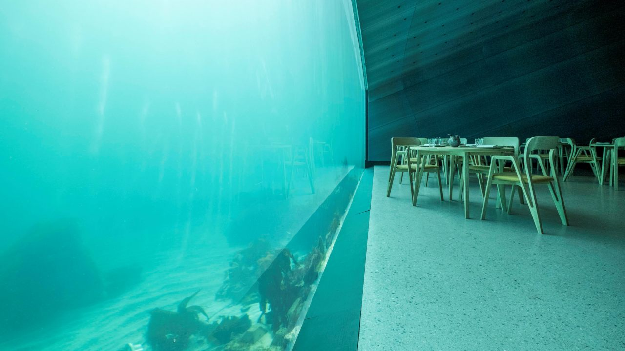 "Under means ""wonder"" in Norwegian, and this superstructure, has taken dining to a whole new level, with a natural co existing progression, between the land, water, sea beds and the sea. The panoramic glass window radiates natural light, flittered with the greenish water colour exhibiting a real marine life tableau. (Image: Reuters)"