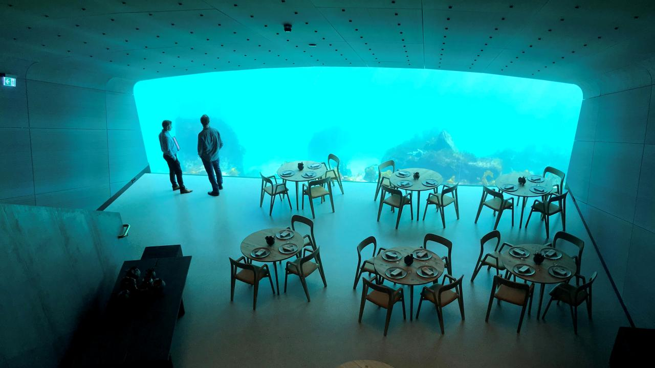 Made public on March 20, the restaurant is already booked with 7000 diners, waiting to relish the dandy cuisine and the sauna like experience walled by a gigantic transparent window to the ocean. Located at the southernmost point of the Norwegian coastline, this magnificent creation is located directly on the sea bed, with more than 16 feet beneath the water's surface. (Image: Reuters)