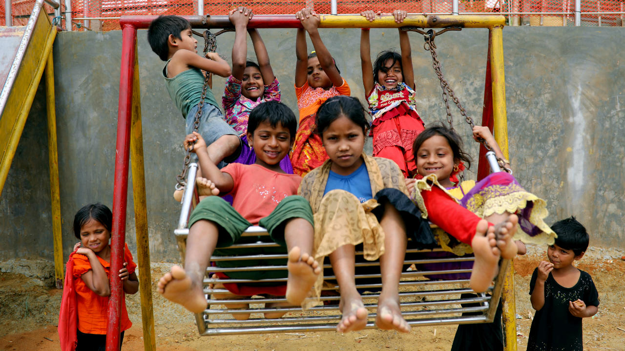 Rohingya refugee children play on a swing at a refugee camp in Cox's Bazar, Bangladesh. (Image: Reuters)