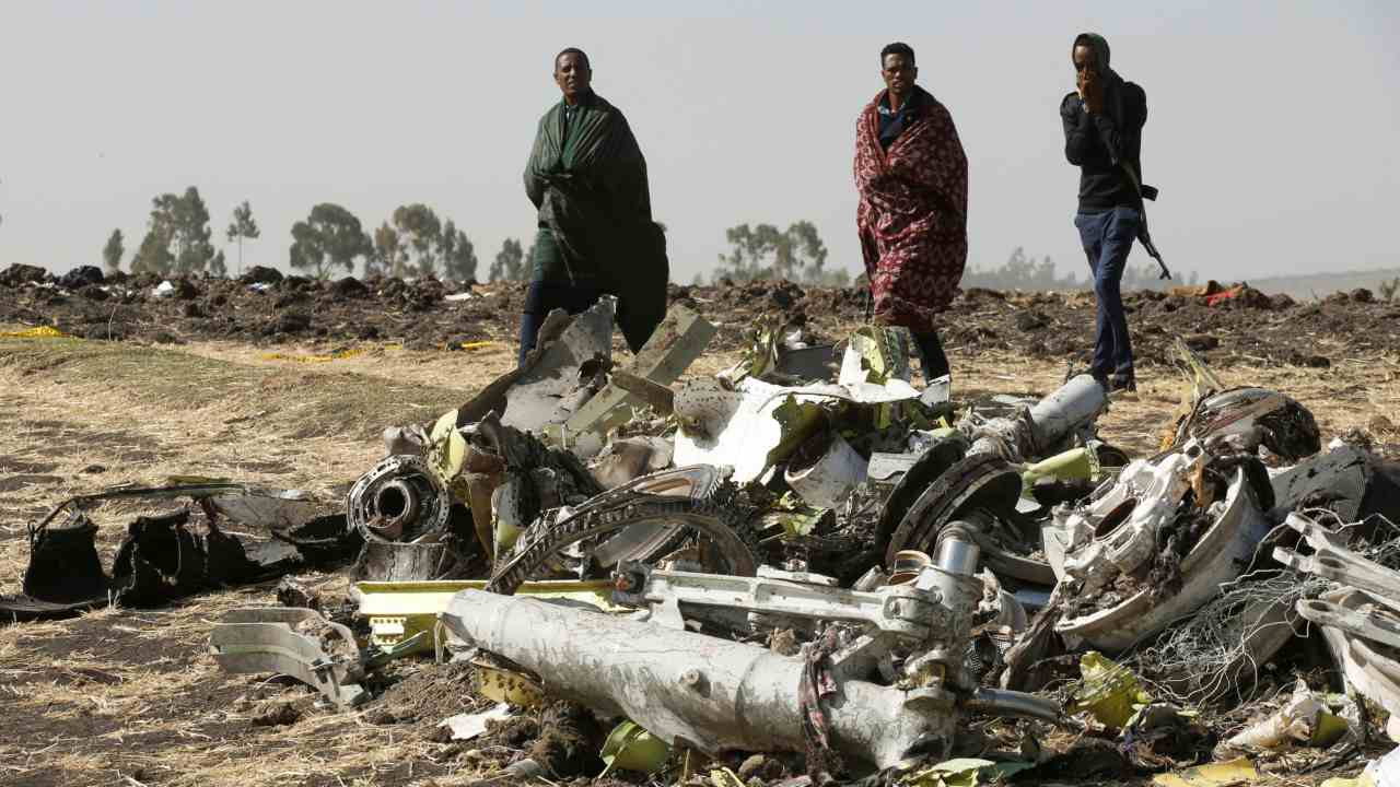 Ethiopian police officers walk past the debris of the Ethiopian Airlines Flight ET 302 plane crash, near the town of Bishoftu, near Addis Ababa, Ethiopia March 12, 2019. (Image: Reuters)