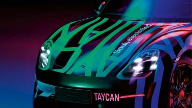 What is Porsche offering in its first electric vehicle Taycan?