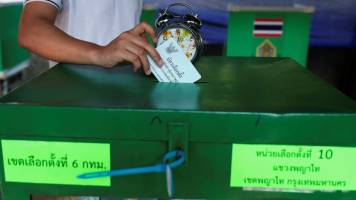 Thai voters go to polls as coup-leader, 'democratic front' face off