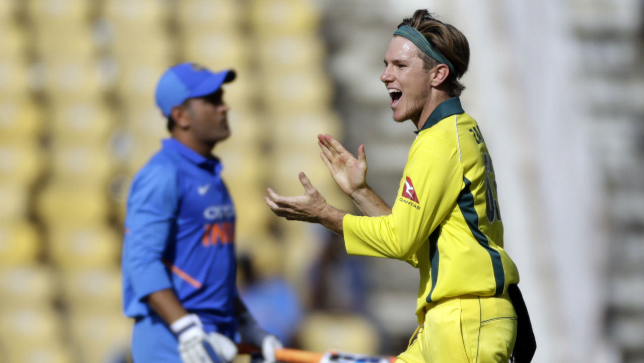 Zampa went on to land a heavy double-blow on India as he dismissed both the heroes from the first ODI, Kedar Jadhav (11) and MS Dhoni (0), in the 33rd over. Kedar was caught at extra cover attempting his favourite inside-out lofted drive and Dhoni was sent back for a golden duck as he edged the ball straight to Khawaja at slip. India were down to 171/6 at the fall of Dhoni's wicket. (Image: AP)