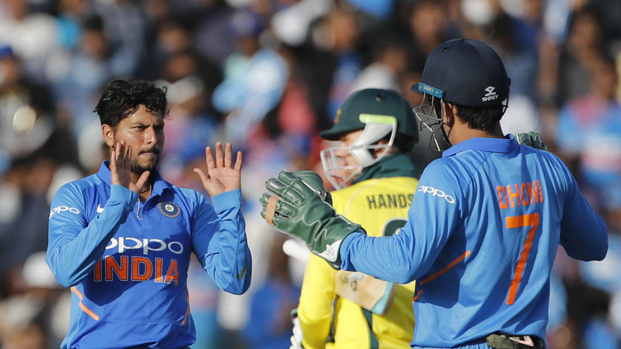 Kuldeep Yadav picked up three wickets in quick succession to stop the Aussies who were marching towards a 350+ score. Maxwell (47) was the first to depart as he was run out thanks to brilliant work from Ravindra Jadeja and Dhoni in the 42nd over. Kuldeep then dismissed Shaun Marsh and Peter Handscomb in the 44th over to reduce the Aussies to 263/5. (Image: AP)