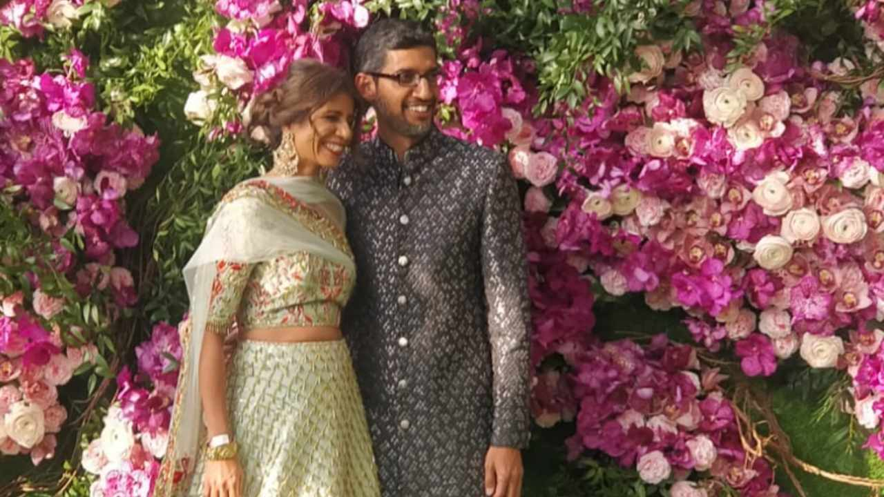 Google CEO Sundarpichai and his wife Anjali Pichai smile for the cameras at Akash Ambani-Shloka Mehta's wedding.