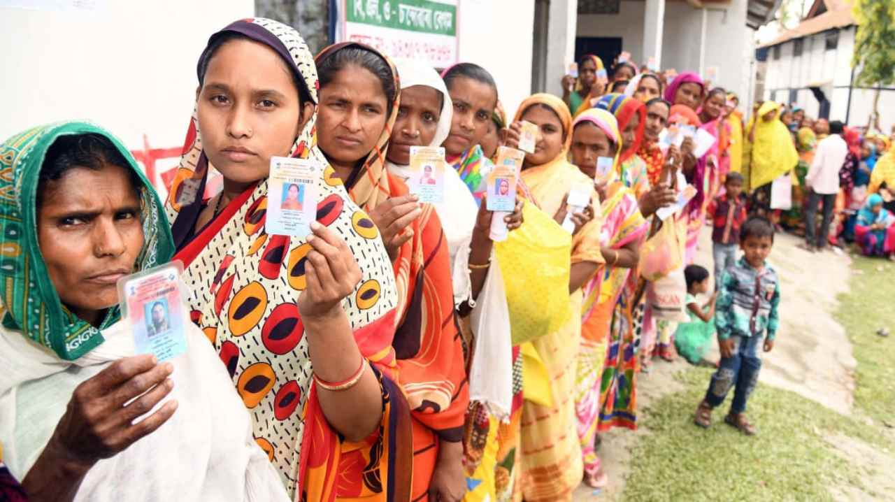 Female voters displaying identity cards, at a polling booth, during the second phase of General Elections 2019, in Assam. (Image:  PIB)