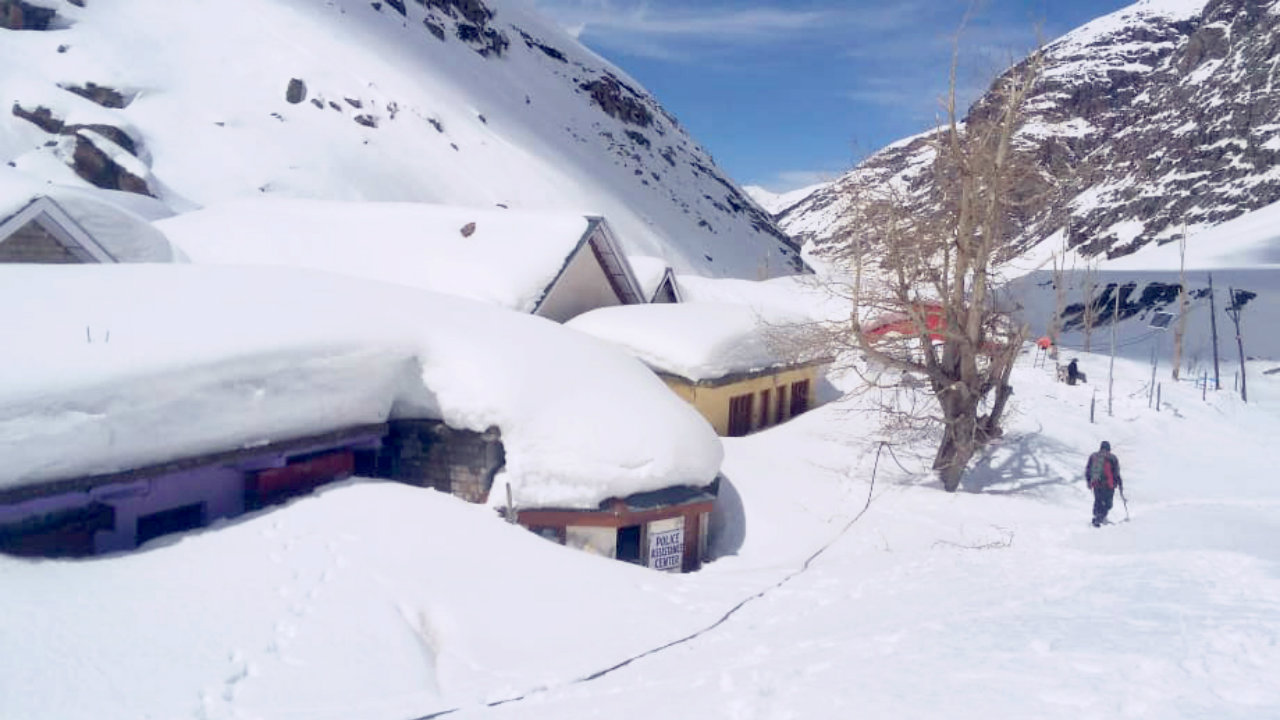 Rescue team in Lahaul-Spiti, Himachal Pradesh monitoring snow clad areas on April 4. (Image: ANI)