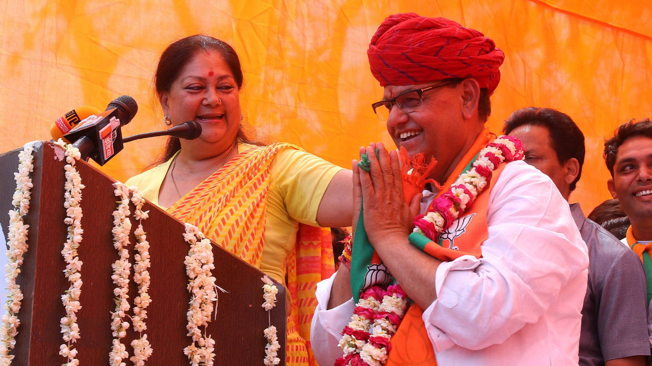 Former Rajasthan Chief Minister Vasundhara Raje with Bharatiya Janata Party (BJP)'s Jaipur (Urban) seat candidate Ramcharan Bohra during the public election meeting ahead of the file nomination for the general elections on April 15. (Image: ANI)