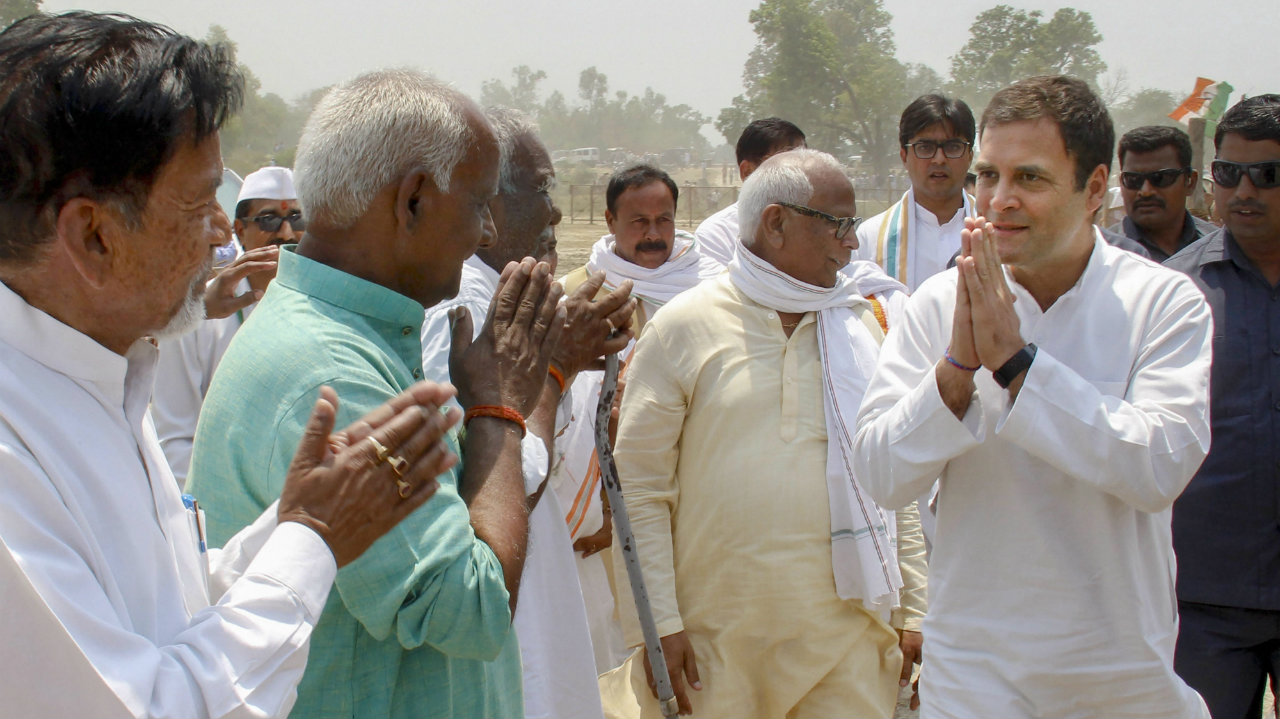 Congress President Rahul Gandhi is greeted by party worker on his arrival at Chaubisi helipad ground, in Barabanki district of Uttar Pradesh on April 22, 2019. (Image: PTI)