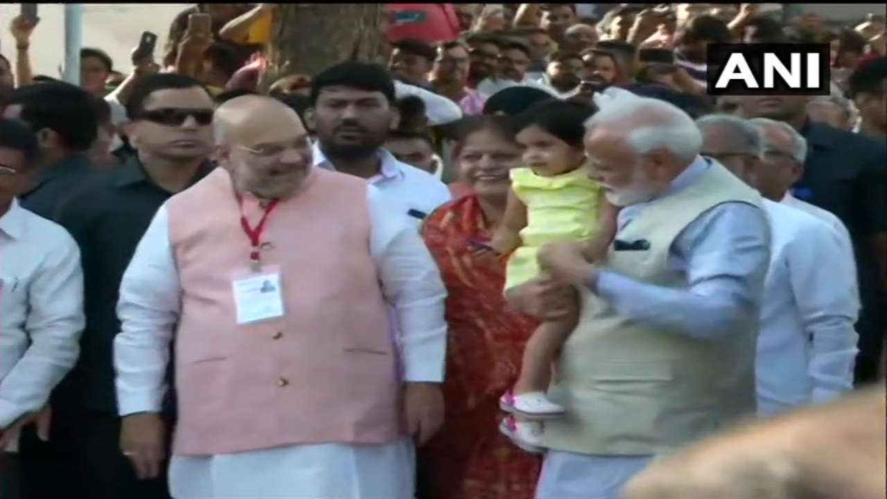 PM Modi arrived to cast his vote at polling booth in Nishan Higher Secondary School in Ranip, Ahmedabad with party president Amit Shah. (Image: ANI)