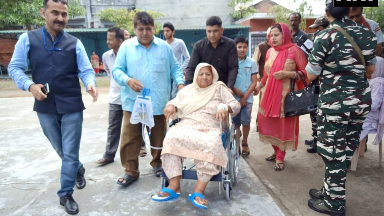 An 80-year-old patient, Jogindero Devi, came from Kathua district hospital at polling booth number 2, in Jammu and Kashmir's Kathua, to cast her vote. She returned to the hospital after casting her vote. (Image: Twitter/@ANI)
