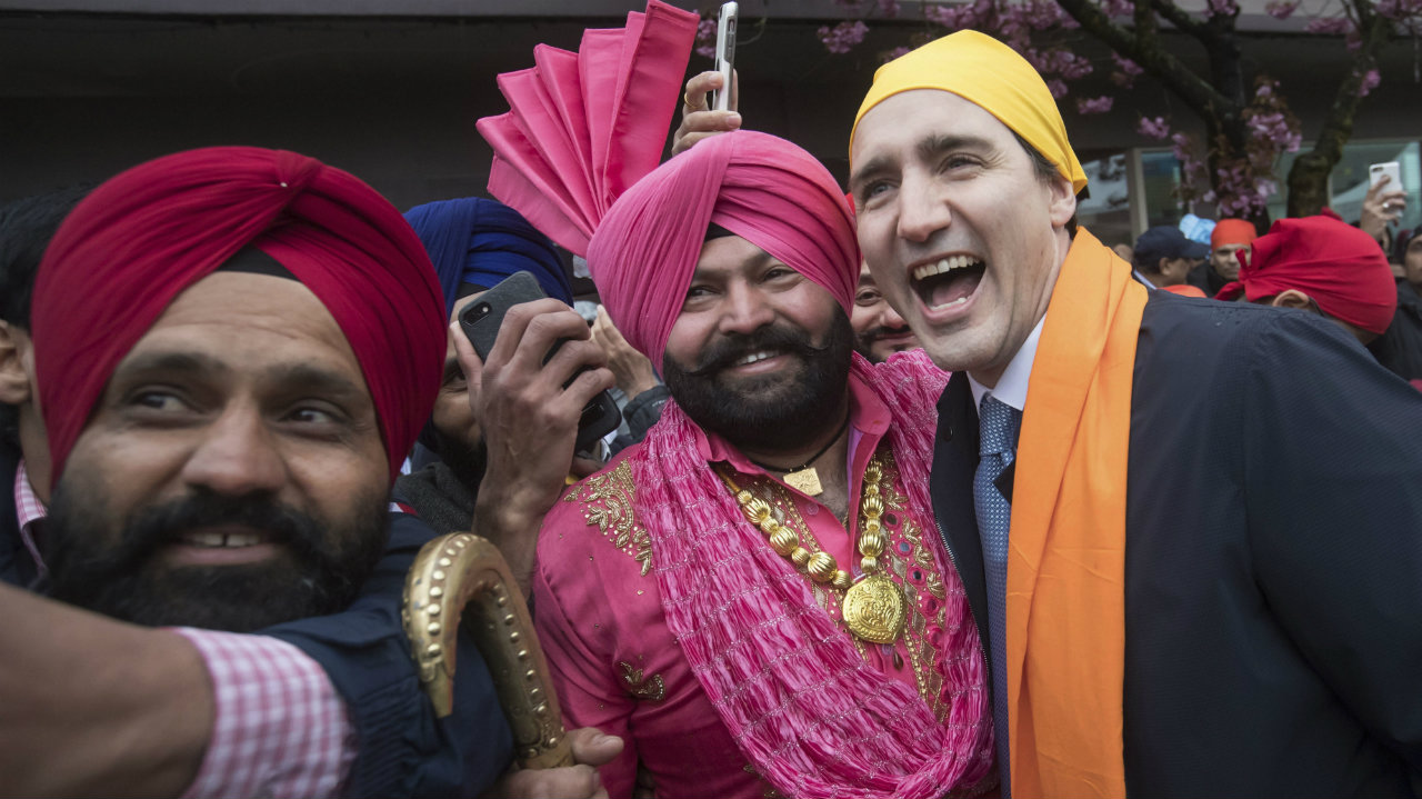 Canadian Prime Minister Justin Trudeau (right) poses for a photograph with Gurmukh Singh (center) after marching in the Vaisakhi parade, in Vancouver, British Columbia, Canada. (Image: AP/PTI)