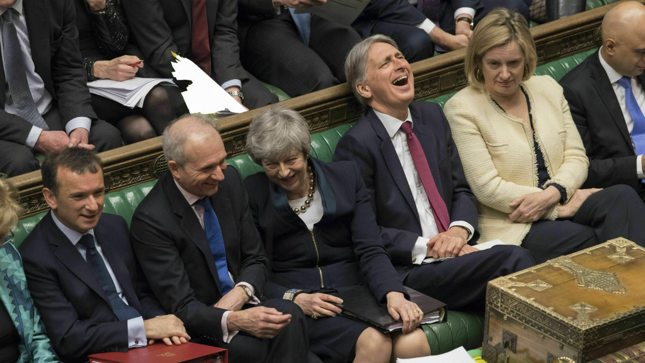 Britain's Prime Minister Theresa May (center) laughs during Prime Minister's question in the Palace of Westminster in London, Britain. A Brexit-related vote in Britain's House of Commons on April 3 ended in a tie, the first time that has happened in a quarter-century. (Image: AP/PTI)