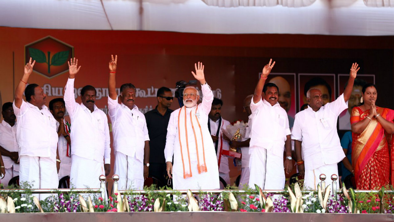Prime Minister Narendra Modi along with Tamil Nadu Chief Minister Edappadi K Palaniswami and Deputy Chief Minister O Panneerselvam at a rally in Andipatti, Tamil Nadu on April 13. (Image: Twitter/@AIADMKOfficial)